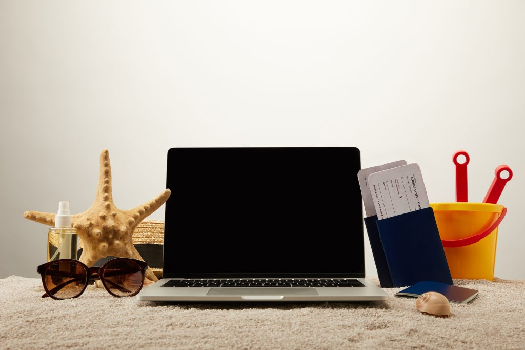Toes in the Water, Laptop in Hand: Busted Working on Vacation